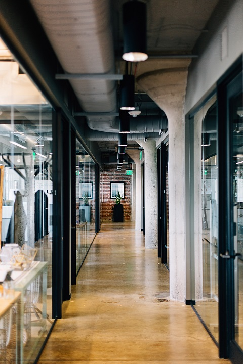 Modern industrial office hallway with exposed ceilings