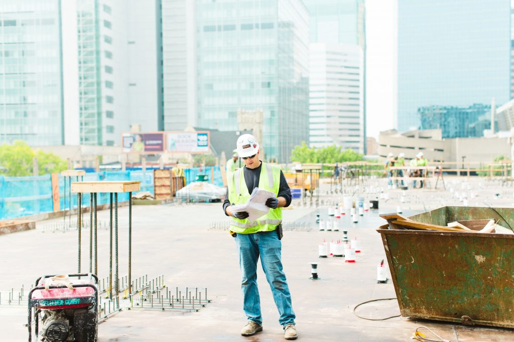 construction worker wearing safety gear on a construction site